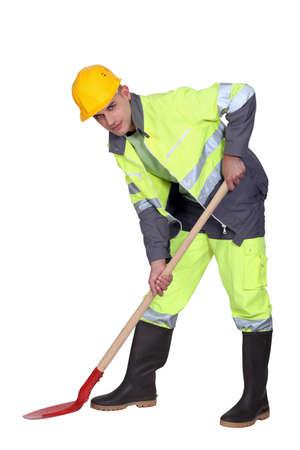 Labourer shovelling Stock Photo - 12910134