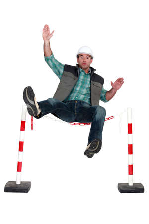 Workman falling over a safety barrier Stock Photo - 12909961