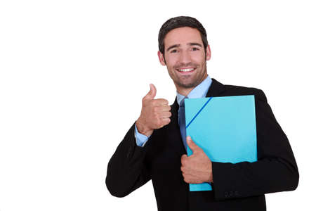endorsement: Businessman holding a folder and giving the thumb