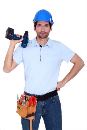 Irritated tradesman holding a battery-powered screwdriver Stock Photo - 12912866