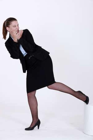fleeing: An apprehensive businesswoman