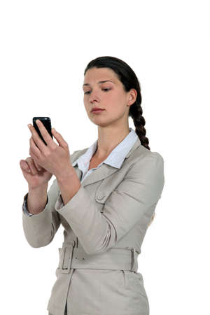 A businesswoman checking her Smartphone  photo
