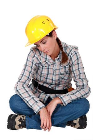 cheerless: Sad female construction worker