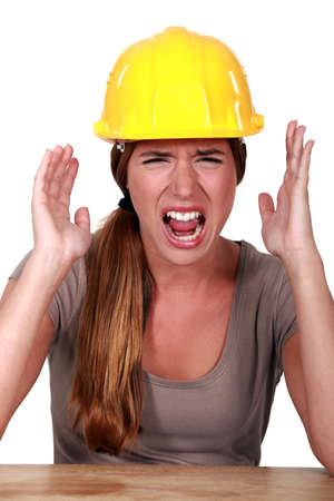 Woman with helmet screaming photo