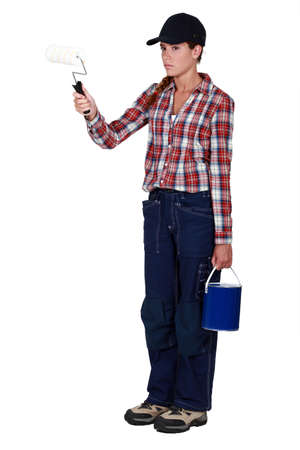 grouchy: Angry tradeswoman holding a paint roller