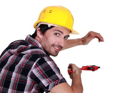 Plumber with vernier caliper Stock Photo - 12915543