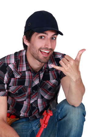 A male construction worker making a hand sign  Stock Photo - 12728926