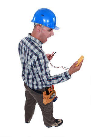 electrician looking at his measurement tool and screaming of surprise Stock Photo - 12910882