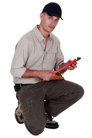 delimit: Man with vernier caliper