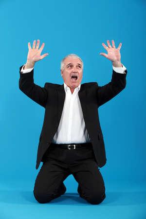 greying: Terrified businessman Stock Photo