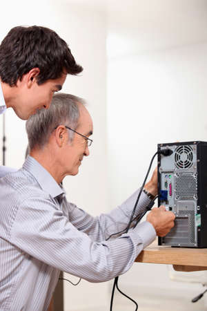 Father and son repairing PC photo