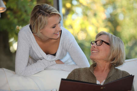 Young woman spending time with her grandmother photo