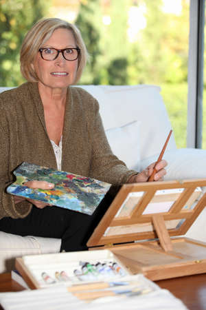 senior woman painting at home Stock Photo - 12729072
