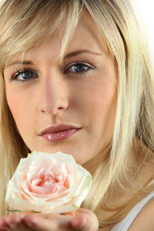 rapturous: Blonde woman with rose in hand