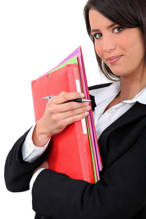 solicitor: Young businesswoman holding folders Stock Photo