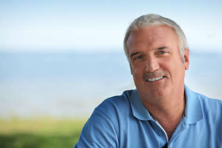 middle aged men: Man wearing blue polo Stock Photo
