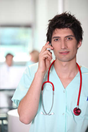 portrait of a male nurse on the phone photo