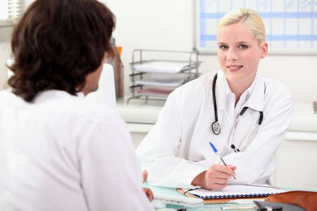 Doctor consulting with a patient photo