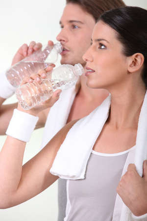 Sporty people drinking water photo