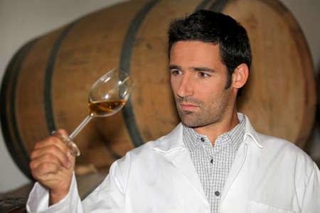 oenology: Man tasting wine