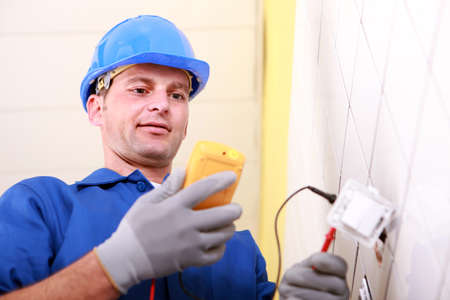 12499503: Electrician using a multimeter