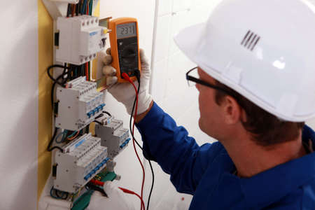 junction: Electrical inspector reading power output Stock Photo