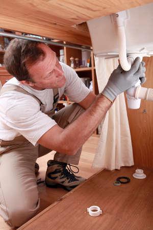 Labourer fixing sink photo