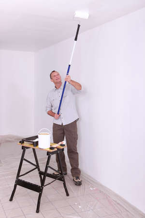 paintbucket: Laborer painting ceiling