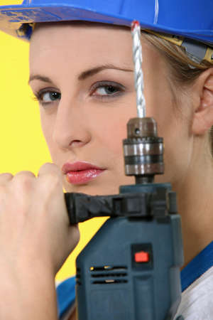 close-up of a woman with drill Stock Photo - 12499623