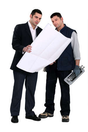 Architect stood with male labourer Stock Photo - 12479254