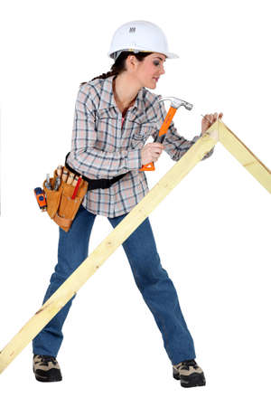 Woman building a frame photo