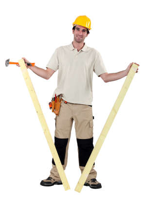 treated board: Worker holding two planks of wood Stock Photo