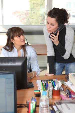 Women working in an office photo