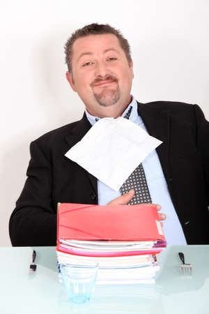 taxman: Man dining on a pile of files Stock Photo