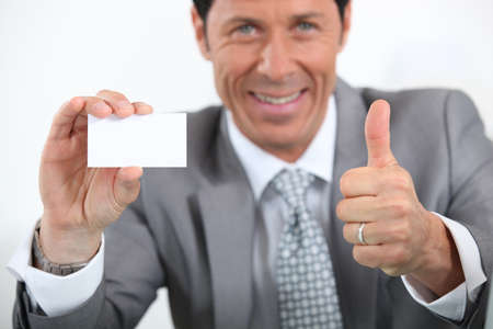 45 49 years: businessman showing card