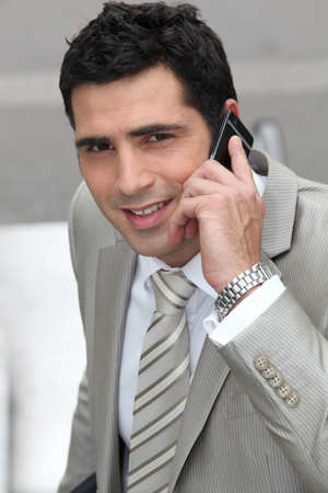 Closeup of a businessman with cellphone Stock Photo - 12500541