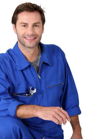 Handyman in overalls photo