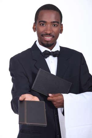 Waiter offering a menu photo