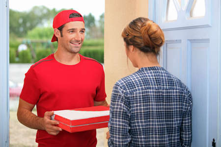 fast delivery: Man delivering pizza Stock Photo