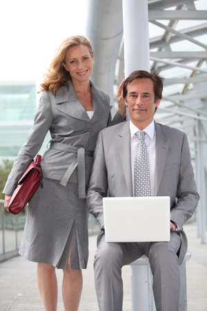 35 39 years: Pair of confident executives with laptop computer Stock Photo