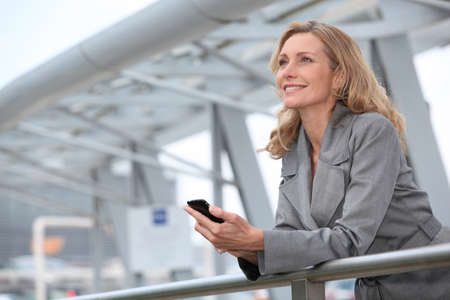 Businesswoman with mobile phone photo