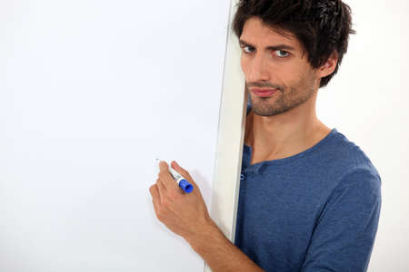 describe: Confused man writing on a whiteboard Stock Photo