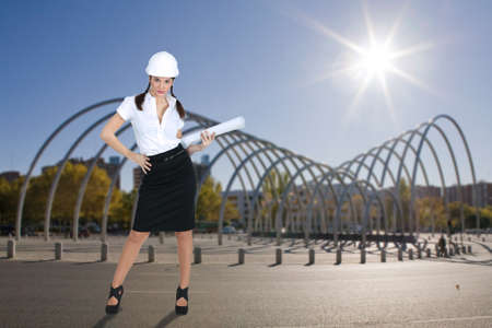 Female architect stood by modern structure photo