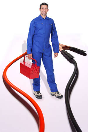 jumpsuit: Tradesman surrounded by jumper cables