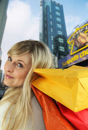 dreamy eyed: blonde carrying shopping bags on shoulder Stock Photo
