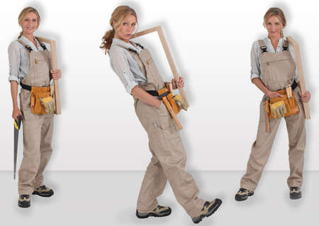 servicewoman: Female carpenter with wooden frame Stock Photo
