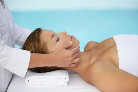 natural healing: Woman having facial massage Stock Photo