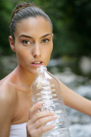 woman drinking fresh spring water nature Stock Photo - 12479370