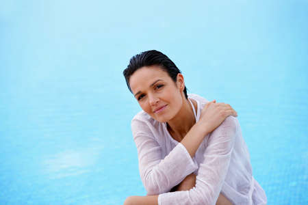 Woman near a swimming pool Stock Photo - 12479210