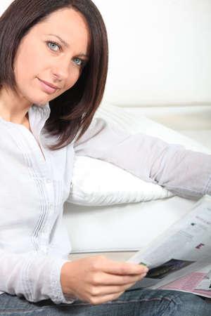 gazette: Woman reading magazine
